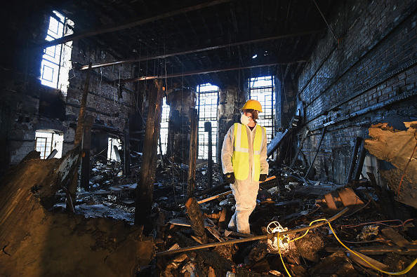 A forensic archaeologist in the Glasgow School of Art, following the disastrous fire. Jeff J Mitchell/Getty Images