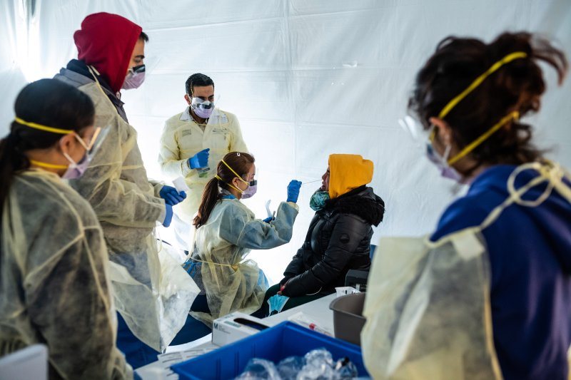 NEW YORK, NY - MARCH 24: Doctors test hospital staff with flu-like symptoms for coronavirus (COVID-19) in set-up tents to triage possible COVID-19 patients outside before they enter the main Emergency department area at St. Barnabas hospital in the Bronx on March 24, 2020 in New York City. New York City has about a third of the nation's confirmed coronavirus cases, making it the center of the outbreak in the United States. (Photo by Misha Friedman/Getty Images)